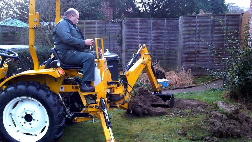 Mini Digger working in a garden