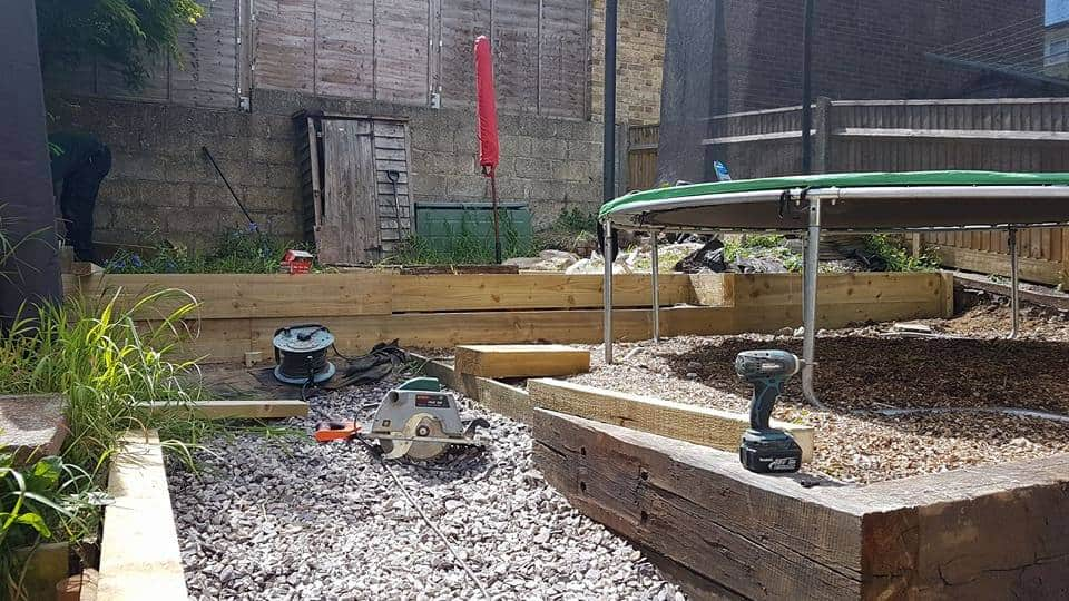 Creating tier paving with softwood edging for this Townhill, Southampton garden project