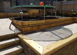 Timber edged, tier patio garden design in Southampton