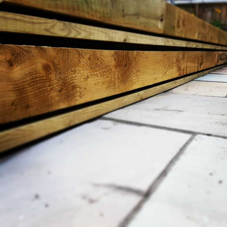 Close up of timber edging for sandstone paving in Southampton