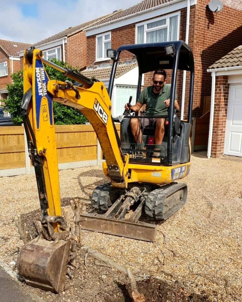 Using a mini digger on a driveway landscaping project