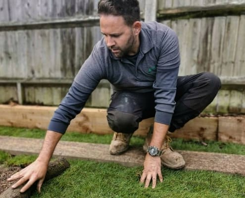 Rob laying new turf to create a lawn